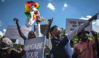 Zimbabweans take to the street to celebrate the coup