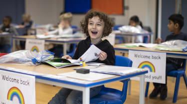 Children sit at socially distanced desks at Harris Academy, London