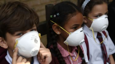 Children wearing face masks.