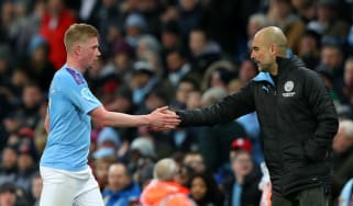 Manchester City's Kevin De Bruyne shakes hands with head coach Pep Guardiola