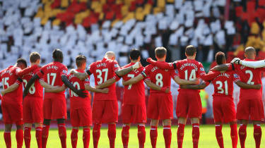 LIVERPOOL, ENGLAND - APRIL 13:The Liverpoolplayers acknowledge a minutes silence for the Hillsborough victims on the 25th anniversary of the tragedy prior to the Barclays Premier League match