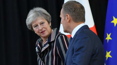 Theresa May talks to European Council President Donald Tusk in Brussels