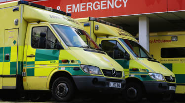 Ambulances parked outside an NHS hospital in London.