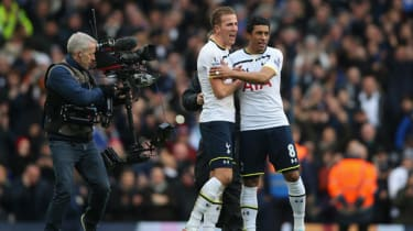Harry Kane of and Paulino celebrate as a television camera films them