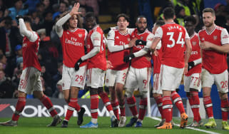 Arsenal players celebrate Gabriel Martinelli's goal against Chelsea at Stamford Bridge
