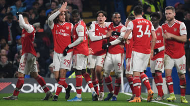 Arsenal players celebrate Gabriel Martinelli's goal against Chelsea at Stamford Bridge
