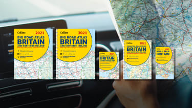 A range of Collins road maps superimposed over a car dash board and an open map