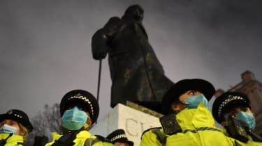 Churchill statue surrounded by police