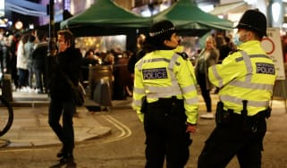 Police patrol Soho after coronavirus restrictions were lifted in April