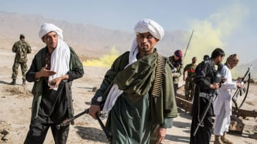 Afghan army cadets dress as Taliban fighters during an exercise