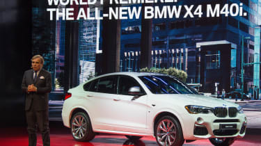 President of BMW North America Ludwig Willisch, unveils the BMW X4 M40i during the BMW press conference at the North American International Auto Show in Detroit, Michigan, January 11, 2016. A