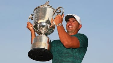 Brooks Koepka lifts the Wanamaker Trophy after his victory at the 2018 US PGA Championship