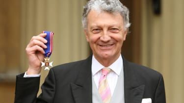 LONDON, UNITED KINGDOM - MARCH 10:Author William Shawcross with his Commander of the Royal Victorian Order (RVO) medal, presented by Britain's Queen Elizabeth II during an investiture ceremon