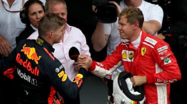 Red Bull driver Max Verstappen shakes hands with Ferrari's Sebastian Vettel