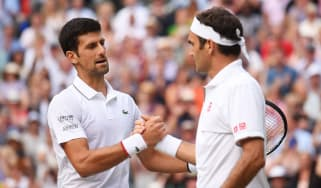 Novak Djokovic shakes Roger Federer's hand after winning the 2019 Wimbledon men's singles final