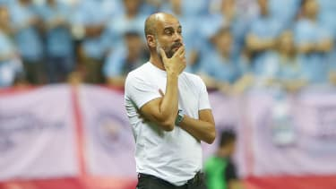 Man City head coach Pep Guardiola watches his side in action against Wolves in Shanghai