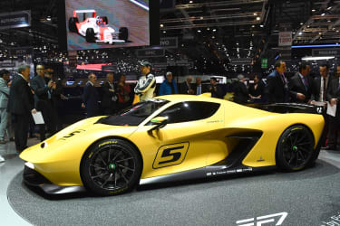 People gather next to the Emerson Fittipaldi EF7on the first press day of the the Geneva International Motor Show on March 7, 2017 in Geneva. Europe's biggest annual car show kicks off in Gen