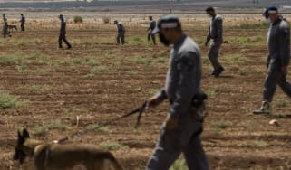 Israeli prison officers conduct a search after the break-out