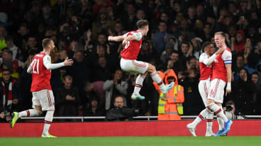 Arsenal captain Rob Holding (far right) celebrates his goal against Nottingham Forest