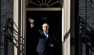 Prime Minister Boris Johnson gestures after giving a speech outside 10 Downing Street in London.