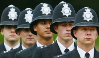 Met police officers stand to attention for the service's 175th Anniversary in 2004