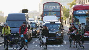 LONDON, ENGLAND - NOVEMBER 15:Cyclists negotiate rush hour traffic in central London near Waterloo Station on November 15, 2013 in London, England. Over the course of the past 10 days, five c
