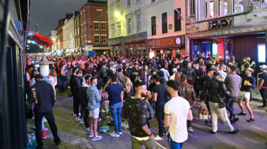 A crowd gathers in Soho, London despite social distancing measures.