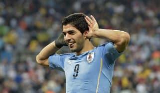 Luis Suarez celebrates after scoring against England