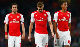 Tomas Rosicky, Calum Chambers and Isaac Hayden look dejected