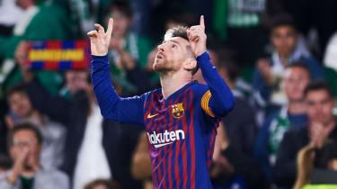 Barcelona captain Lionel Messi celebrates his hat-trick goal against Real Betis