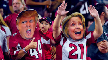 Arizona Cardinals fans wear masks of presidential candidates Donald Trump and Hillary Clinton at an NFL game