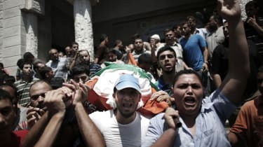 Palestinians carry the body of Mohammad Deif