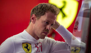 Ferrari driver Sebastian Vettel won four Formula 1 titles with Red Bull
