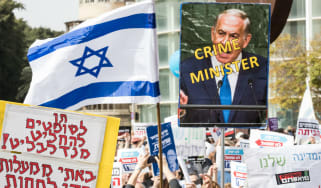 Israeli protesters take to the streets after police recommend indicting Netanyahu