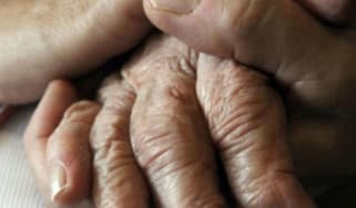 An elderly person's hand