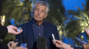 US Secretary of Defense Chuck Hagel speaks with reporters after reading a statement on chemical weapon use in Syria during a press conference in Abu Dhabi, United Arab Emirates on April 25, 2