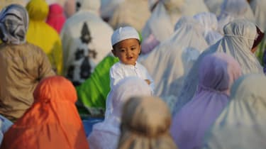 SURABAYA, INDONESIA - SEPTEMBER 24:Indonesian Muslims attend to Eid Al-Adha prayer on September 24, 2015 in Surabaya, Indonesia. Muslims worldwide celebrate Eid Al-Adha, to commemorate the Pr