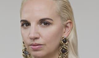 Portrait of Christelle Kocher wearing a black shirt, realised in 2019.