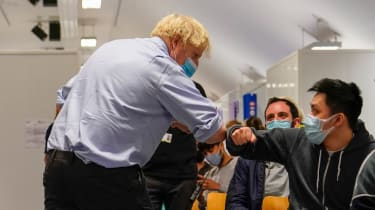 Boris Johnson touching elbows with a member of the public at a hospital