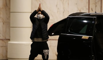 A traveller leaves the Heathrow Radisson Blu after completing the quarantine period