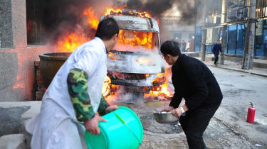 YINCHUAN, CHINA - DECEMBER 01: (CHINA OUT) Rescuers battle an ambulance fire outside a pharmacy at Xingqing District on December 1, 2014 in Yinchuan, Ningxia province of China. An ambulance p