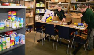 Volunteers pack food at a food bank