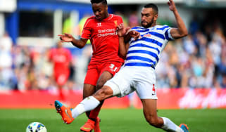Raheem Sterling and Steven Caulker battle for ball