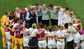 England head coach Phil Neville speaks to his squad after the Fifa Women's World Cup win against Scotland