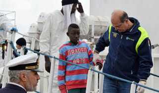 Migrant on Italian coastguard boat