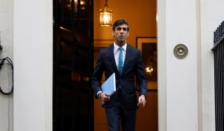 Rishi Sunak carries a copy of his Spending Review 2020 as he leaves 11 Downing Street.