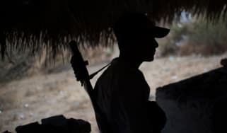 A Guerrero Community Police member stands guard at a checkpoint in Apaxtla de Castrejon, Guerrero state, Mexico, on March 26, 2018. - In the mountainous area of Guerrero state, one of the poo