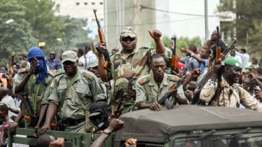 Protesters greet soldiers in the Malian capital Bamako