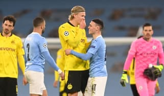 Erling Haaland speaks with Phil Foden after the Champions League clash at the Etihad