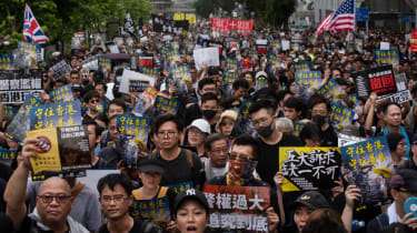 HONG KONG, CHINA - 2019/07/14: Huge crowd of pro democracy protesters with placards during the demonstration.Thousands of pro-democracy demonstrators took to the street once again in a new wa